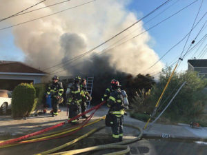 Fire crews battling second-alarm fire at residence on Hilltop Drive in San Carlos